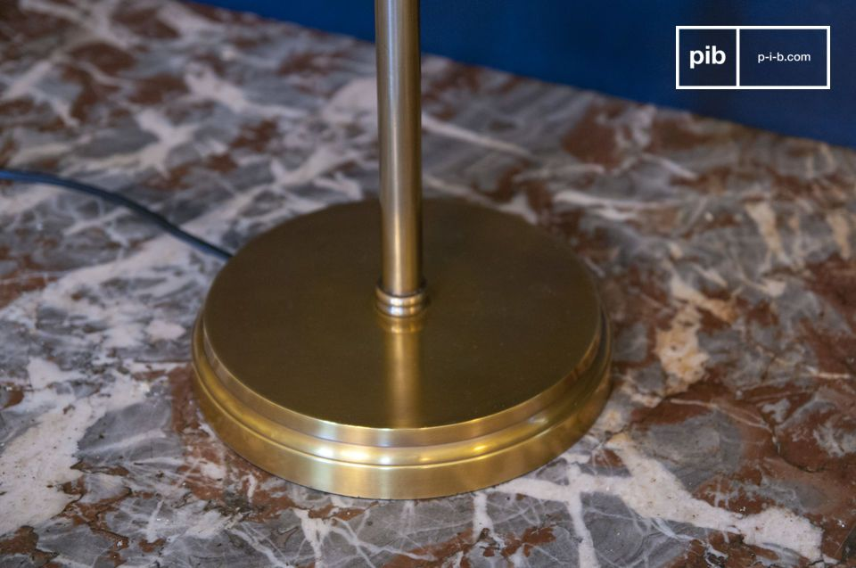The Amber gold brass table lamp is inspired by traditional banker or library lamps to give an