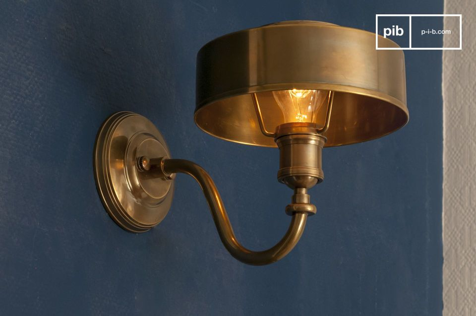 A warm and charamatic golden wall lamp