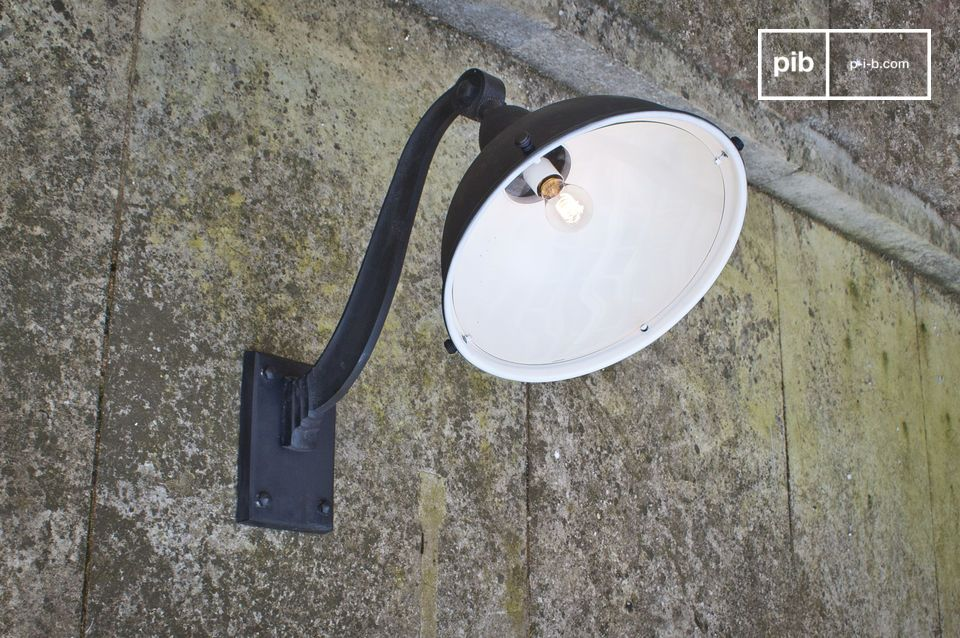 A pretty industrial lamp at ease indoors and outdoors.