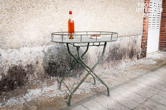 Green woven metal folding table