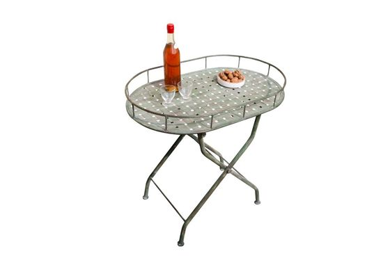 Green woven metal folding table Clipped