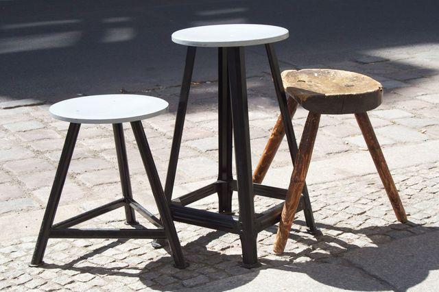 three wooden stools