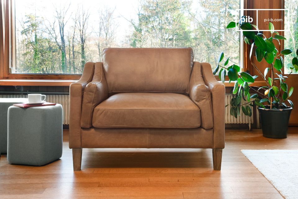 An elegant sand-coloured armchair 100% full grain leather