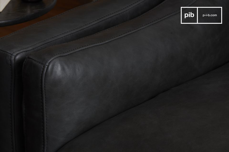 A superb dark grey full grain leather armchair of great size