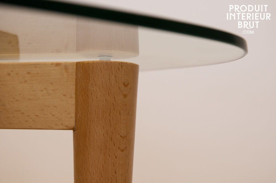 The glass top of the Höti table seems to be floating on three lightly conical legs linked by a
