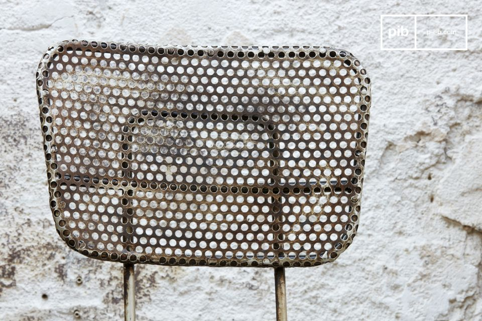 This industrial chair has vintage style as it is made of perforated metal sheeting that has been