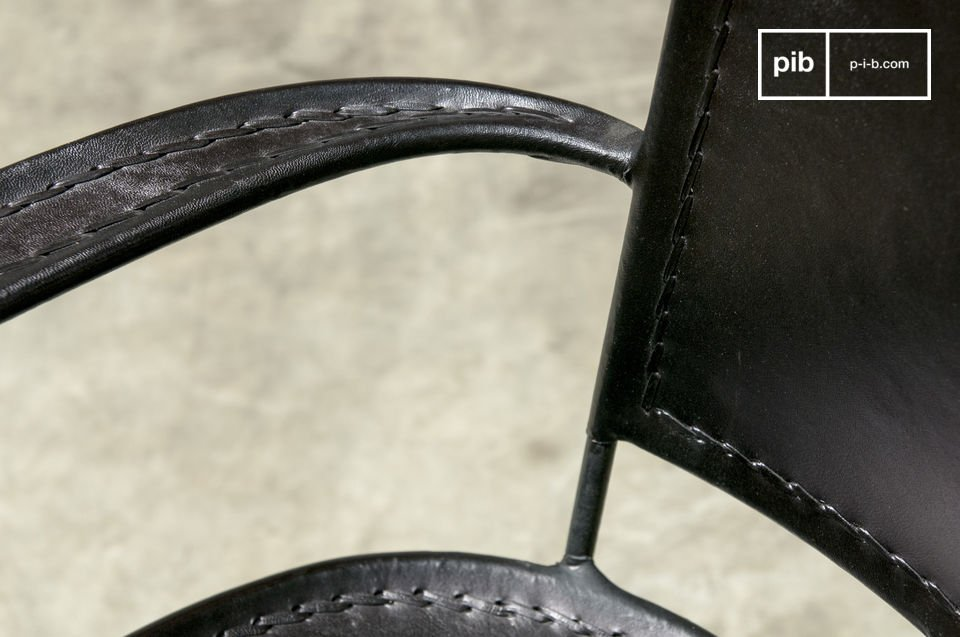 A black leather armchair, sober and robust
