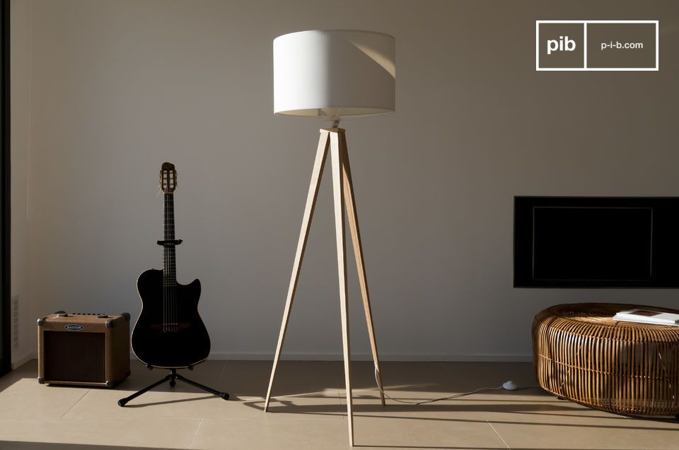 Large tripod floor lamp with white lampshade.