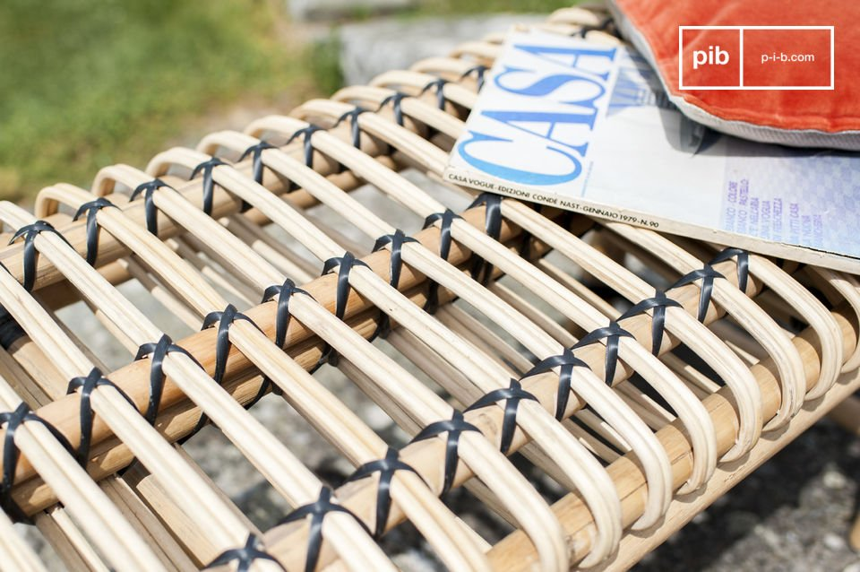 The small bench is made out of rattan material that has been assembled and braided by hand