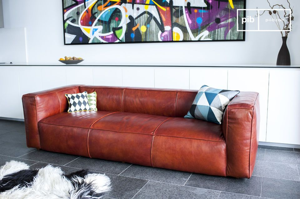 The unique aesthetic of the sofa is inherently vintage in nature due to its beautiful reddish
