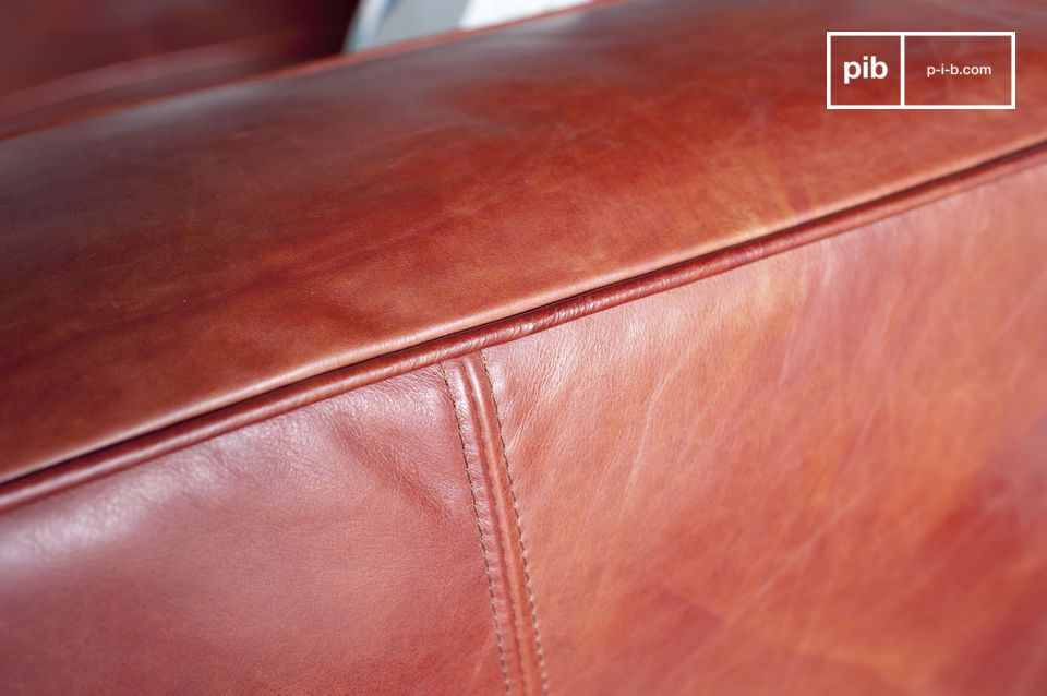Pretty coral tone of the leather which gives a soft warmth to the sofa.
