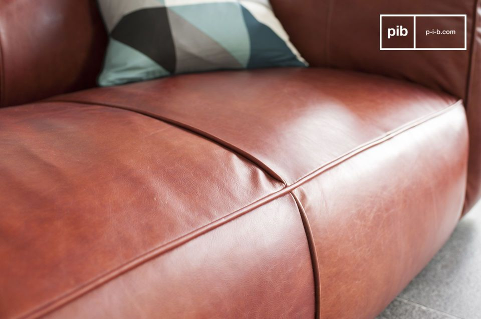 The three seats of this leather sofa are quite deep just as the armrests