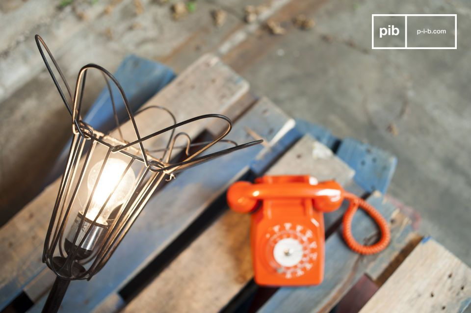 The lamp is reminiscent of the lamps that could be found in old workshops