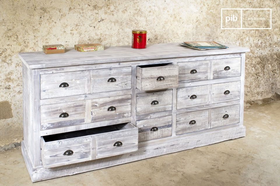 This industrial piece successfully blends the practical nature of a chest of drawers with the