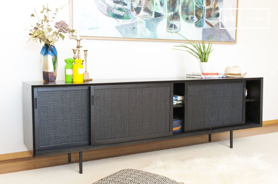 The natural weave that covers the doors of this low buffet gives it an elegant and original touch
