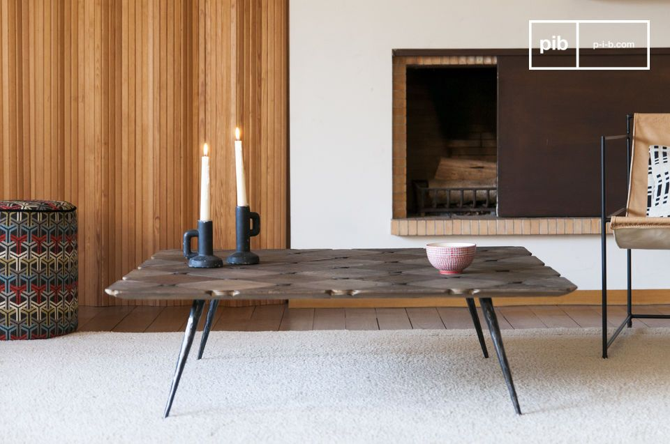 Large coffee table with slanted legs reminiscent of chopsticks.