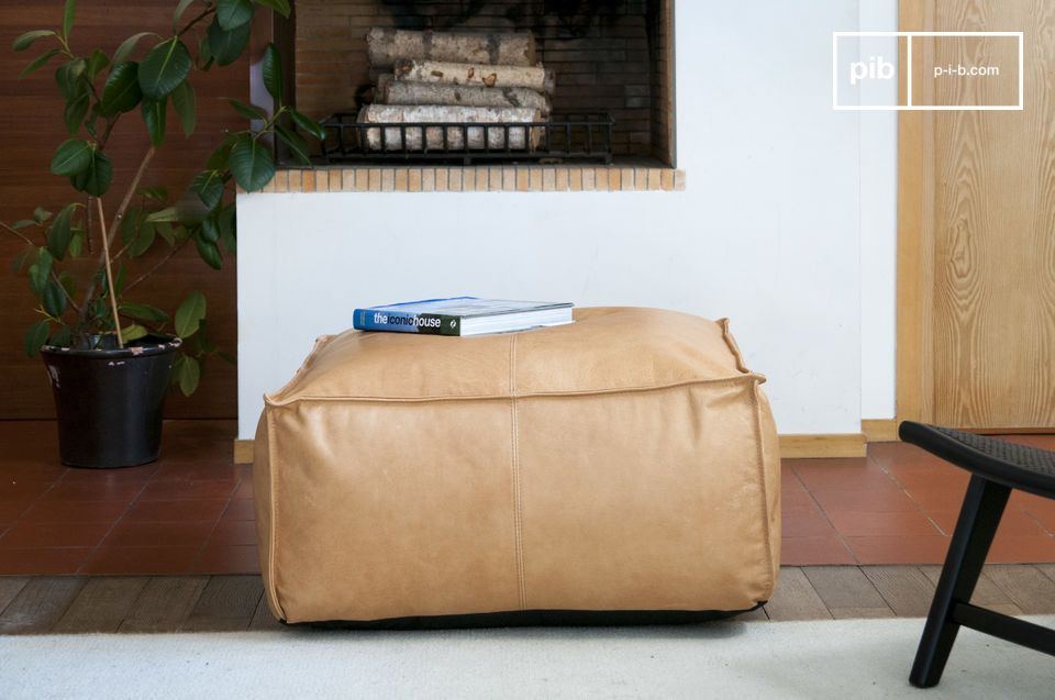A large, warm and comfortable leather pouf.