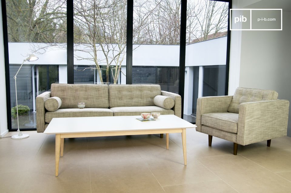 This sofa lays claim to a fifties look with its cylindrical armrests and compass legs