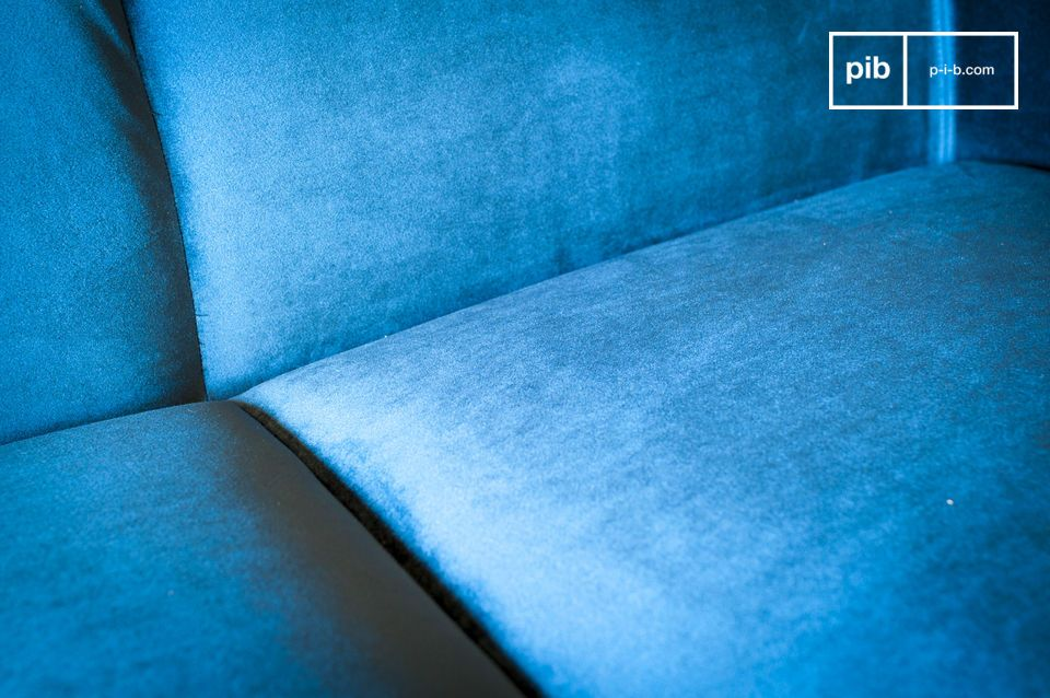 This deep blue velvet is part of the Viela sofa\'s timeless vintage look and is easy to adapt to a