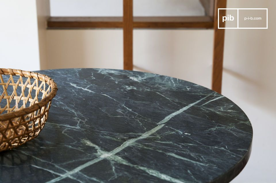 This table in the shape of a pedestal table with a marble-veined top is remarkable for its elegance