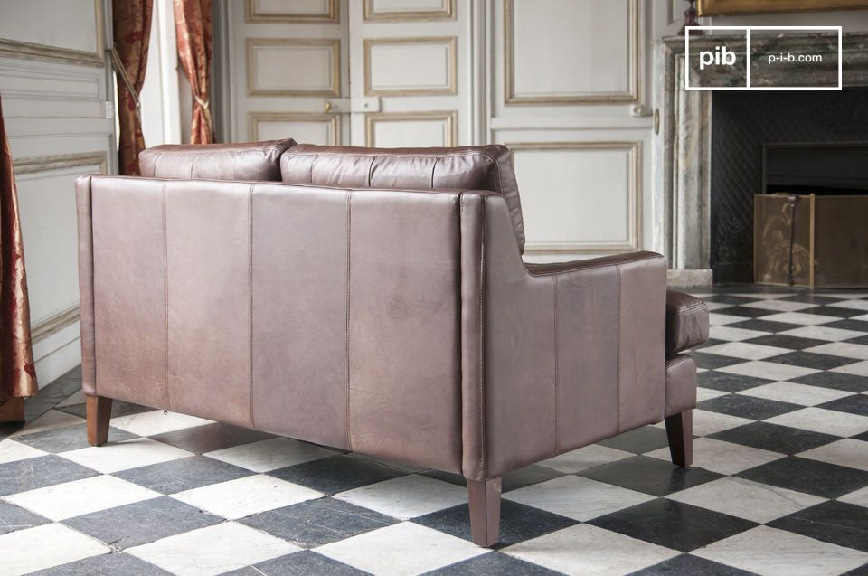Combined with a beautiful coffee table this two-seater shabby chic sofa in full grain leather will