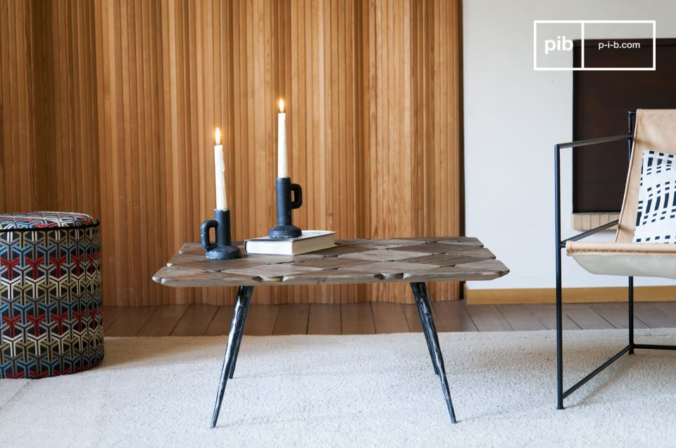 This unusual coffee table with its narrow bevelled legs will bring style and lightness to a