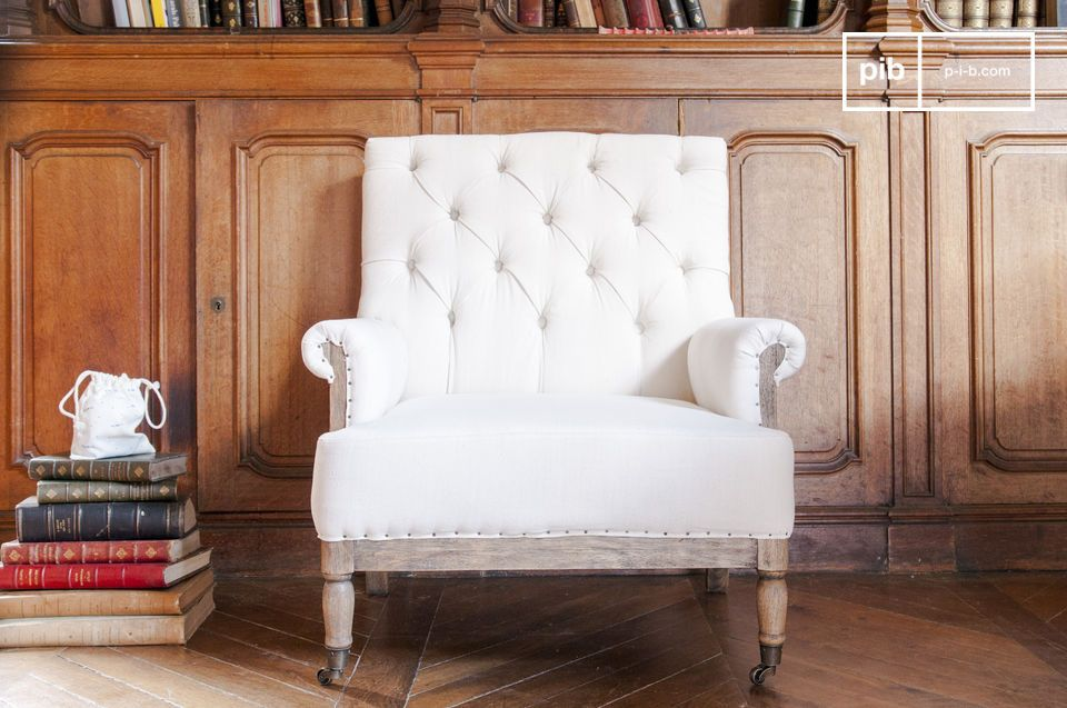 A white linen armchair with a huge cachet.