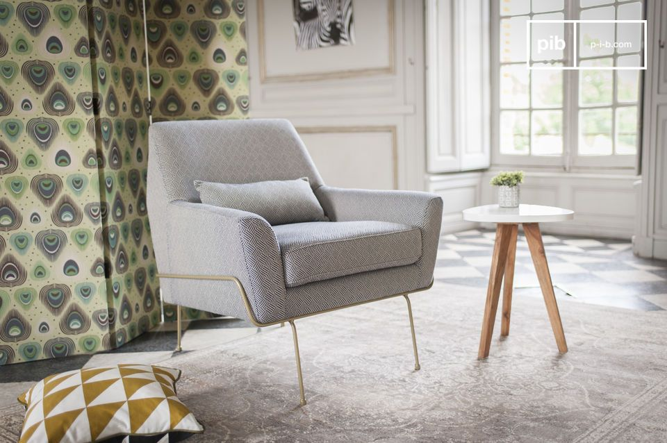 A typical 60's fabric armchair with retro pattern