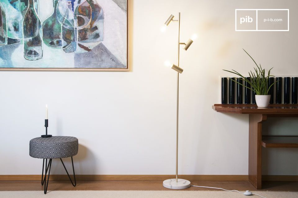 A gilded metal and retro marble floor lamp with a distinguished look.