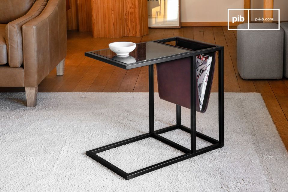 A magazine table in leather and elegant black marble.
