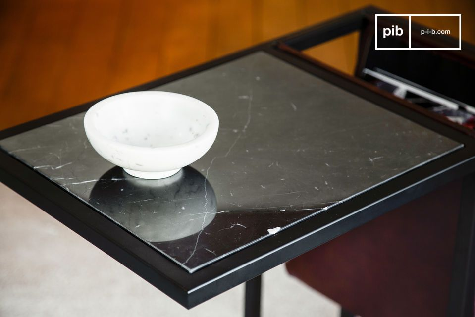Beautiful black marble top with white veining.
