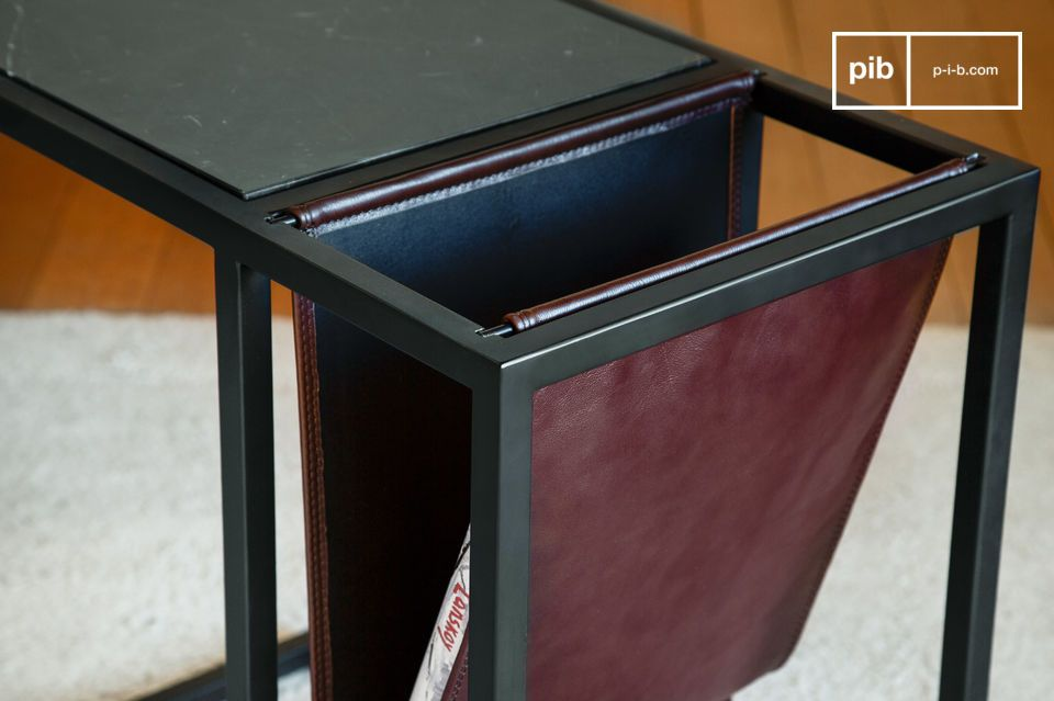 The pretty leather magazine rack has a beautiful burgundy colour.