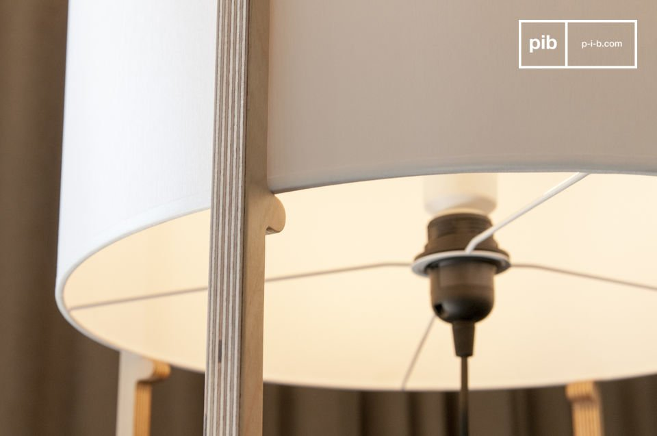 A wooden structure with finess that supports a lampshade and  is reminiscent of the simplicity of