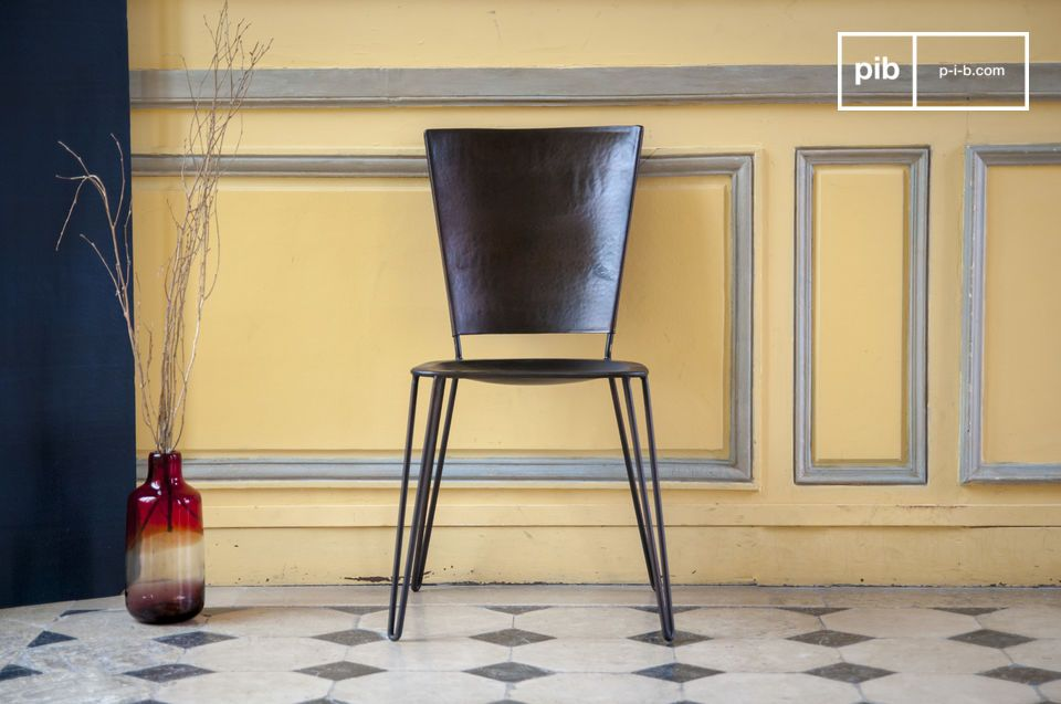 A metal chair with an industrial look, beautiful lines and comfortable