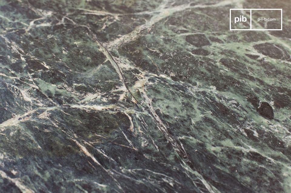 Large, deeply matt, ribbed green marble top.