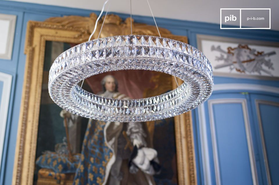 The Monte Carlo glass chandelier consists of hundreds of bevelled glass rectangles hand-assembled on