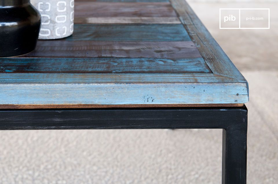 The patina finish applied to the table was achieved by applying multiple layers of paint and varnish