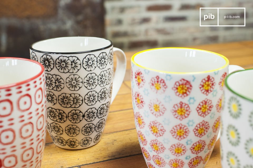 The 4 mugs are made out of porcelain and differ from each other in color and motifs