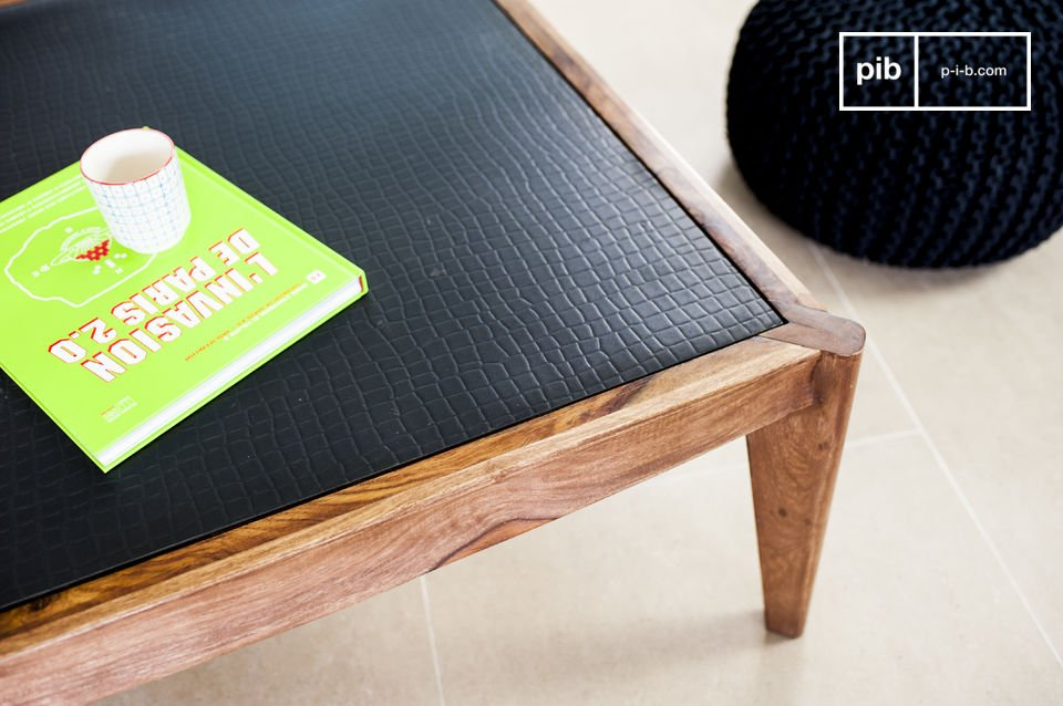 An elegant, original coffee table made of solid wood
