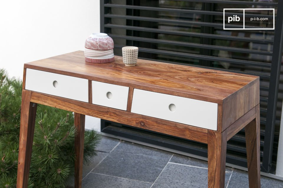This console is made entirely out of solid pink wood, which with its natural pattern is a beautiful contrast with the white drawers