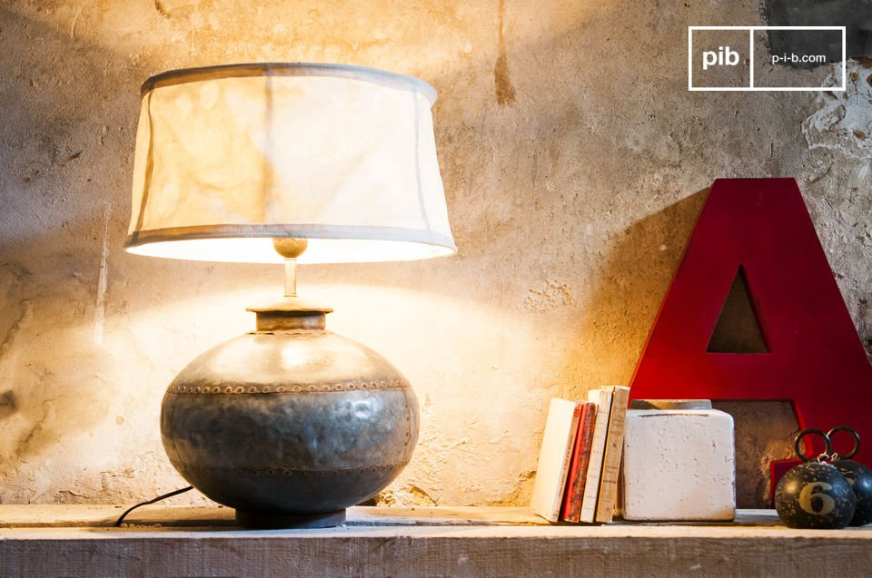 The Nessos table lamp is an unusual design of an old container making it a very unique decorative object