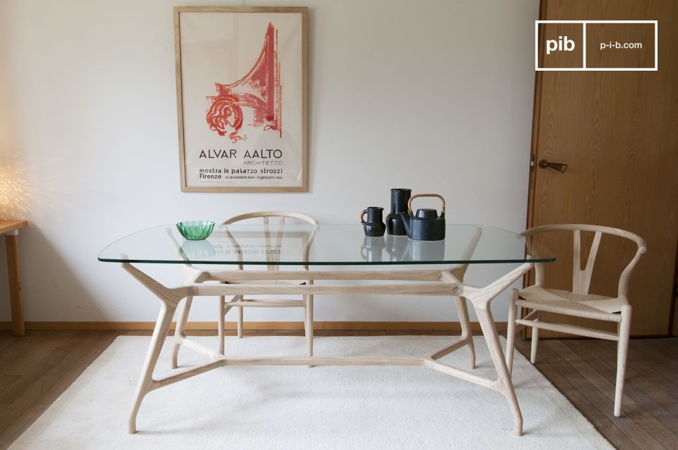 A glass and clear wood dining table with a vintage Nordic style