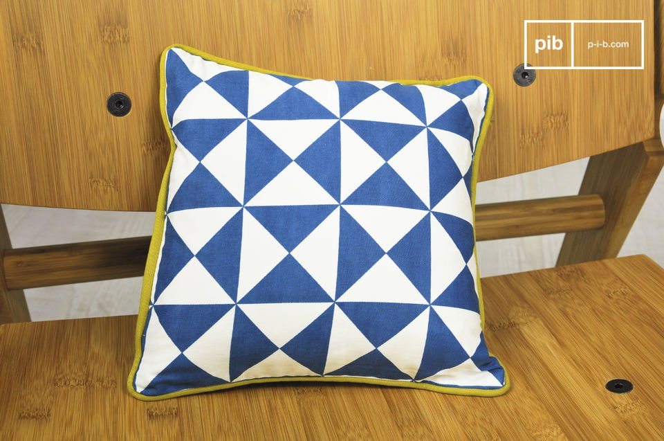 A small cushion made entirely of organically-grown cotton, and printed with triangular patterns inspired by the 1950s