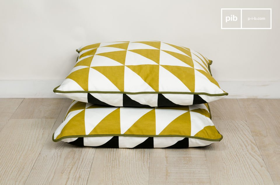A cushion made entirely out of organic cotton, and printed with triangular patterns inspired by the 1950s