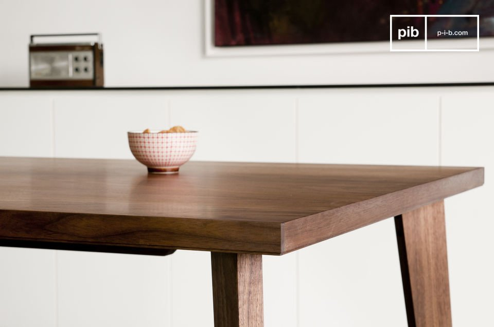 This walnut table with its fine harmonious lines is inspired by mid-century Scandinavian design