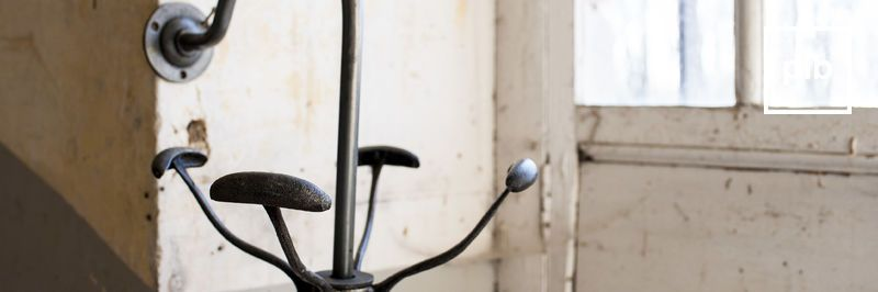 Old collection of industrial metal coat stands
