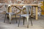 Old collection of metal industrial chairs