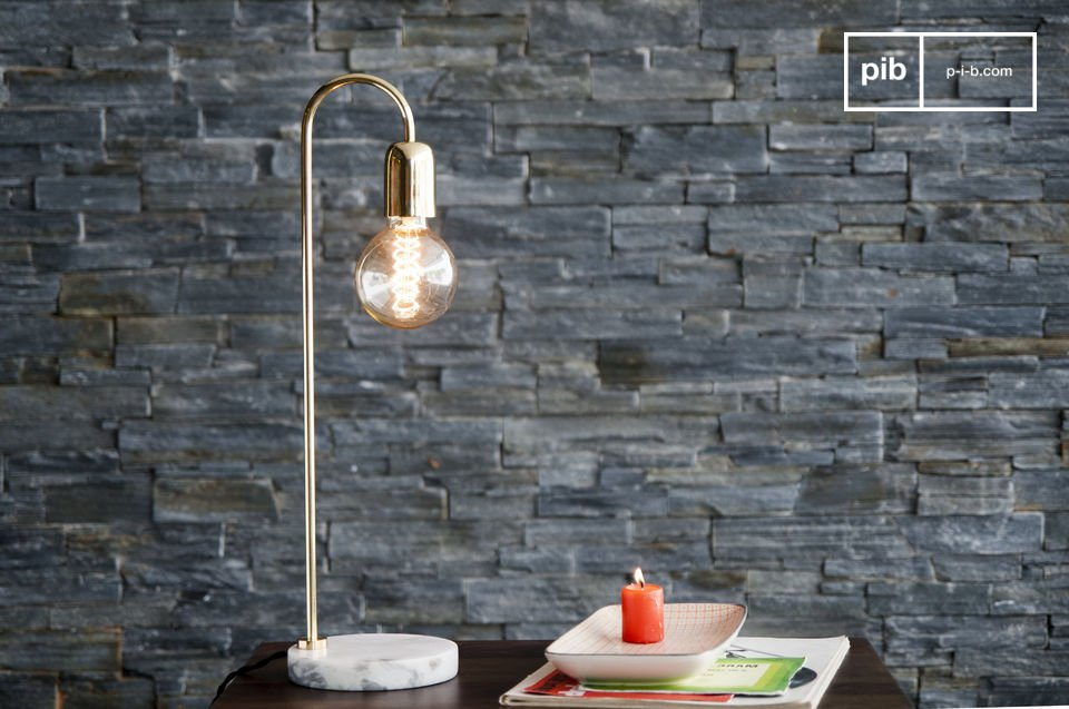 The Ora table lamp is an outstanding fixture in a classic Scandinavian design, created in marble and polished brass