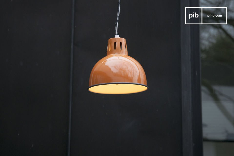 The beautiful orange finish on the suspension SNÖL will make your ceiling shine and bring a warm colour to your interior