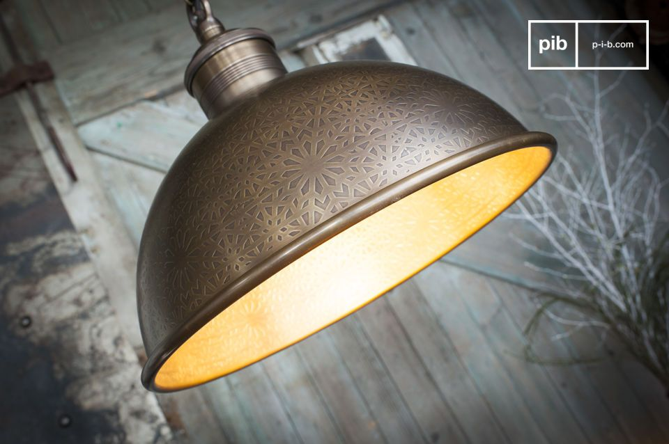 The Orient-Express engraved metal pendant lamp is distinguished by its bell-shaped design and by